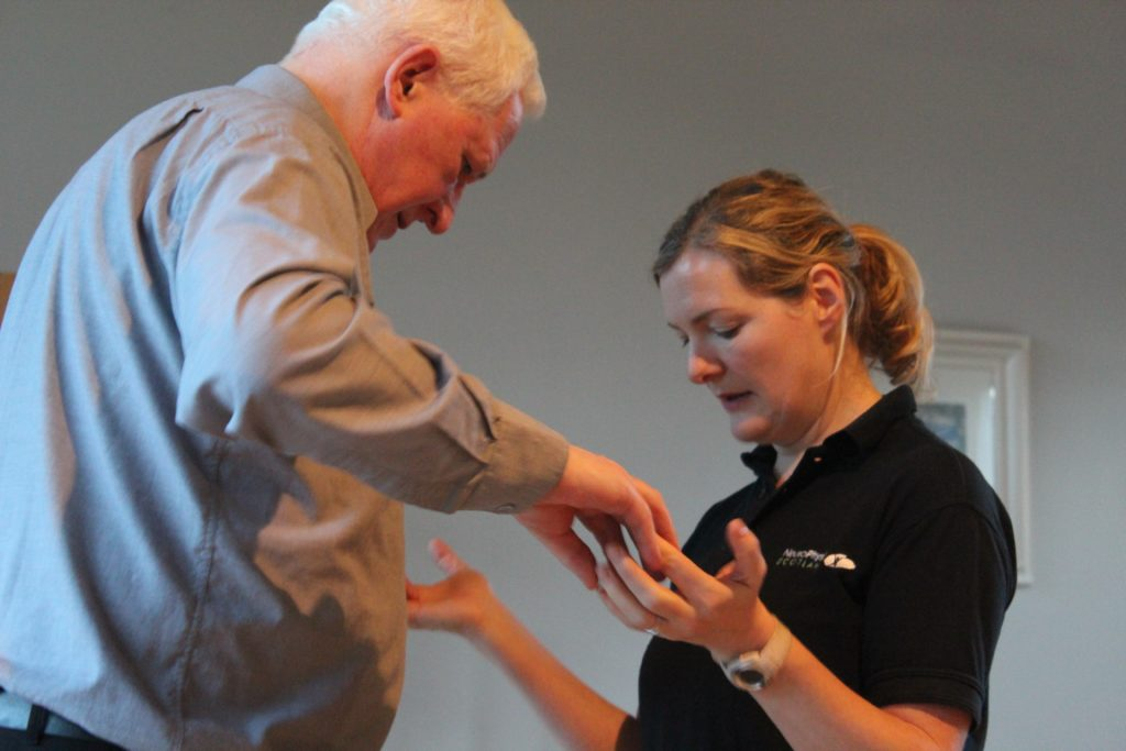 man receiving physio support from woman