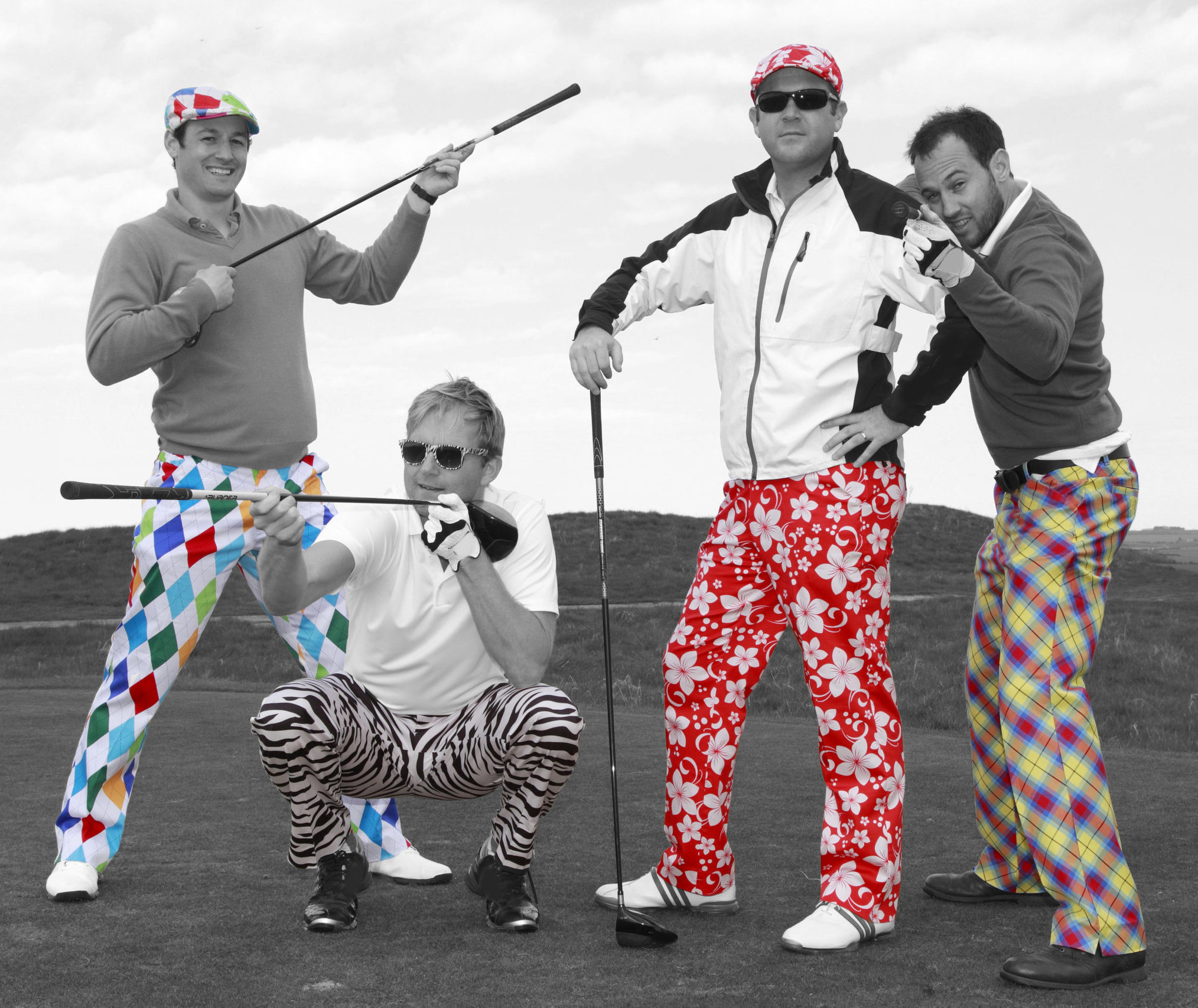 four men posing at golf course