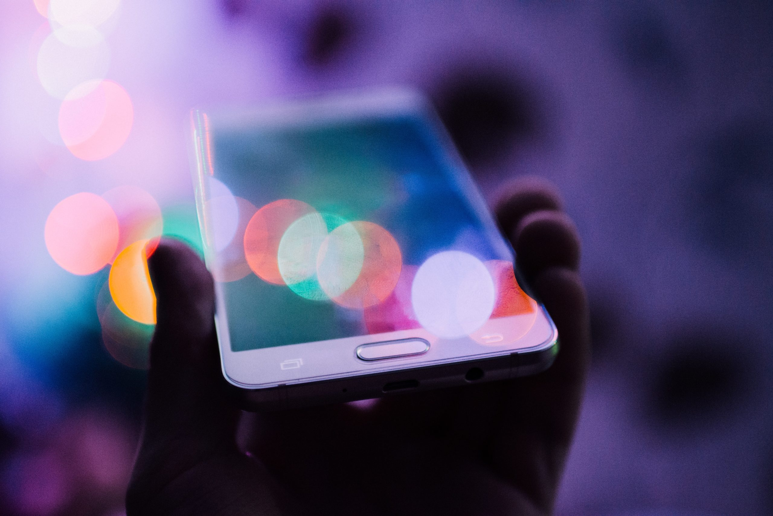 mobile phone in colourful lights
